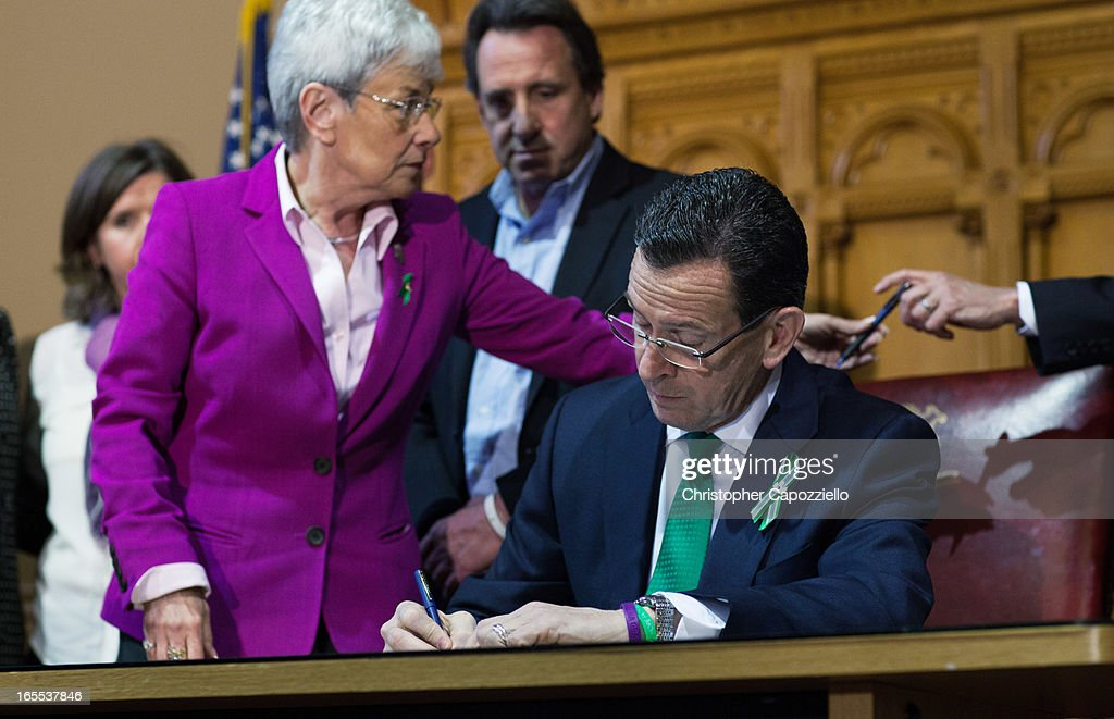 Connecticut Gov. Dannel Malloy (R) signs a gun-control bill April 4, 2013 in Hartford, Connecticut. After more than 13 hours of debate, the Connecticut General Assembly approved the gun-control bill early April 4, that proponents see as the toughest-in-the-nation response to the Demember 14, 2012 Newtown school shootings.