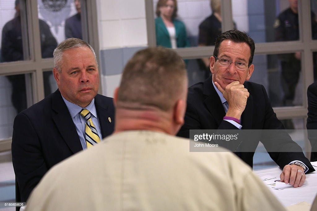 Connecticut Governor <a gi-track='captionPersonalityLinkClicked' href=/galleries/search?phrase=Dannel+Malloy&family=editorial&specificpeople=7234470 ng-click='$event.stopPropagation()'>Dannel Malloy</a> (R), and CT Correction Commissioner Scott Semple (L), meet with prisoners at the new DUI unit of the Cybulski Community Reintegration Center on April 1, 2016 in Enfield, Connecticut. Malloy's 'Second Chance Society' which he signed into law in July 2015, has been described as at the cutting edge of criminal justice reform efforts nationwide. The DUI unit is designed to prepare non-violent inmates convicted of driving under the influence of drugs or alcohol for reintegration into society at the end of their prison sentences. The initiative is also supported by Mothers Against Drunk Driving.
