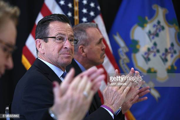 Connecticut Governor Dannel Malloy applauds during the dedication ceremony of the new DUI unit of the Cybulski Community Reintegration Center on...