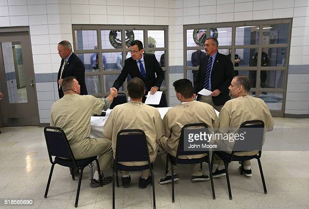 Connecticut Governor Dannel Malloy meets with prisoners at the new DUI unit of the Cybulski Community Reintegration Center on April 1 2016 in Enfield...