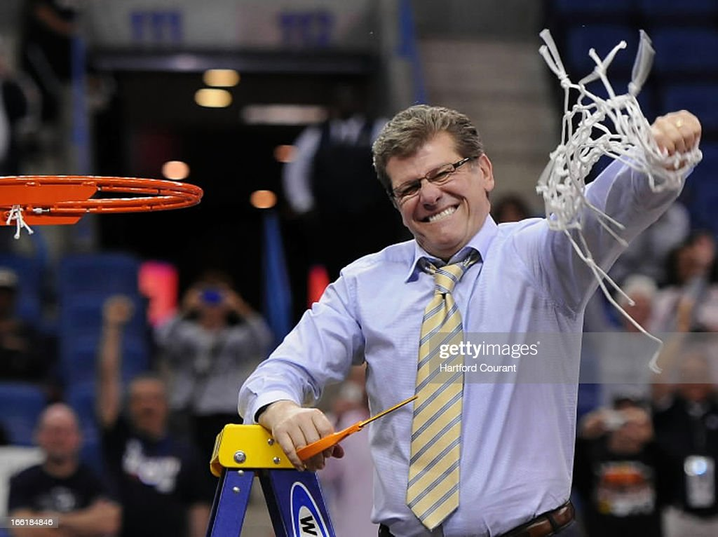 Connecticut head coach Geno Auriemma pumps his fist after cutting down the net following a 93-60 win against Louisville in the women's NCAA Tournament finals at New Orleans Arena in New Orleans. Louisiana, Tuesday, April 9, 2013.