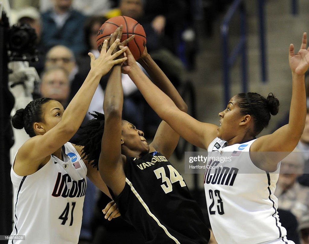 Connecticut Huskies center Kiah Stokes (41) and Connecticut Huskies forward Kaleena Mosqueda-Lewis (23) double team Vanderbilt Commodores forward Tiffany Clarke (34) during the second half of the women's NCAA Tournament at Gampel Pavilion in Storrs, Connecticut, Monday, March 25, 2013.