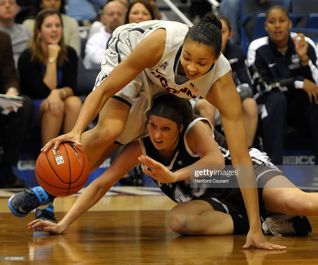 Connecticut Huskies center Kiah Stokes (41) battles St. Bonaventure Bonnies forward Katie Healy (42) for a loose ball in the second half as the University of Connecticut women Huskies basketball team beat the St. Bonaventure Bonnies 88-39 in the Basketball Hall of Fame Women's Challenge at the XL Center in Hartford, Conn., Sunday, November 24, 2013.