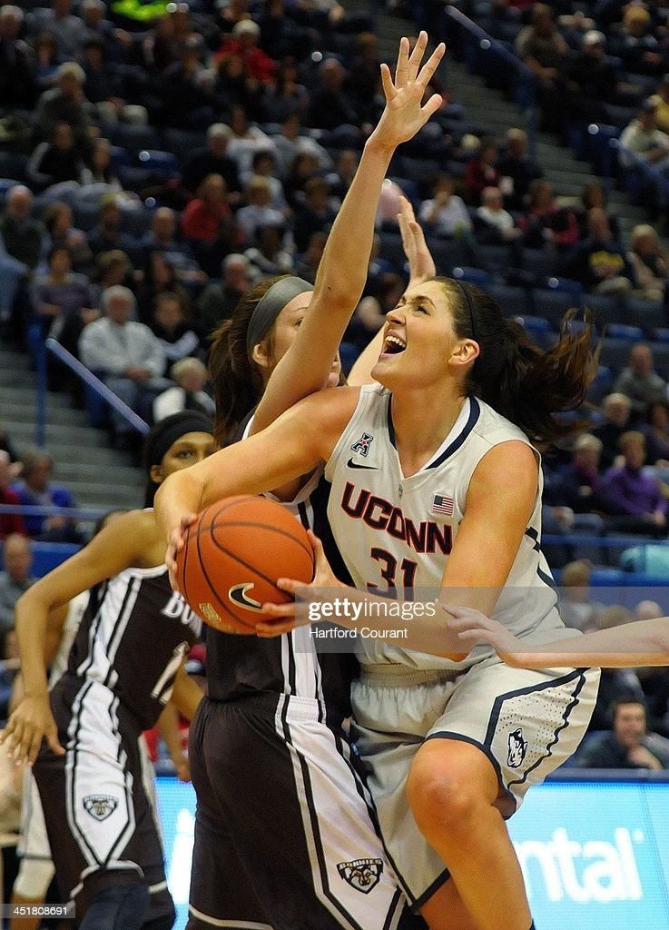Connecticut Huskies center Stefanie Dolson (31) drives to the basket against St. Bonaventure Bonnies forward Katie Healy (42) in the second half as the University of Connecticut women Huskies basketball team beat the St. Bonaventure Bonnies 88-39 in the Basketball Hall of Fame Women's Challenge at the XL Center in Hartford, Conn., Sunday, November 24, 2013.