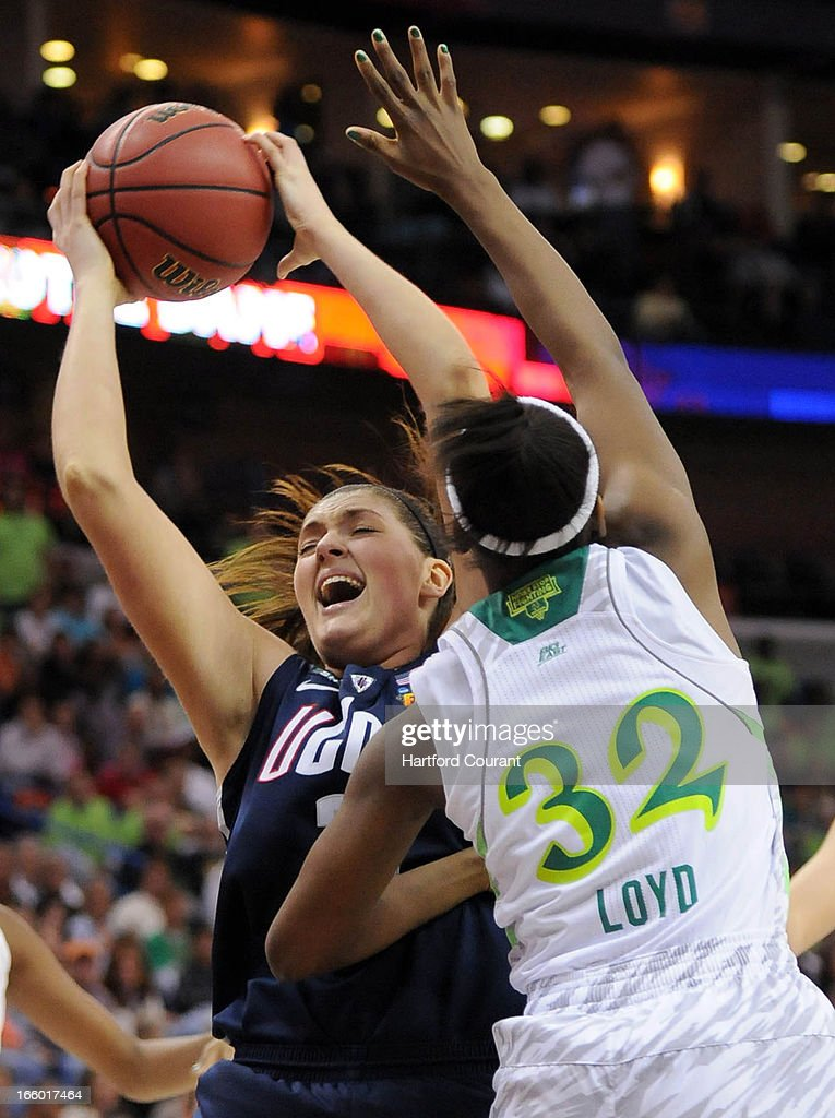 Connecticut Huskies center Stefanie Dolson (31) pulls in an offensive rebound while defended by Notre Dame Fighting Irish guard Jewell Loyd (32) in their semi-final game at the NCAA during the women's NCAA semifinal in New Orleans, Louisiana. UConn won, 83-65.