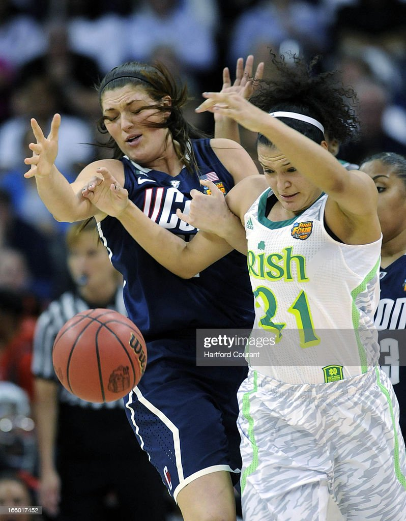 Connecticut Huskies center Stefanie Dolson (31) strips the ball from Notre Dame Fighting Irish guard Kayla McBride (21) during the first half of the women's NCAA semifinal in New Orleans, Louisiana. UConn won, 83-65.