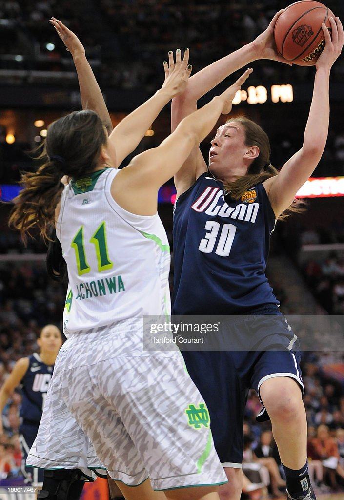 Connecticut Huskies forward Breanna Stewart (30) drives to the hoop while Notre Dame Fighting Irish forward Natalie Achonwa (11) defends during the women's NCAA semifinal in New Orleans, Louisiana. UConn won, 83-65.