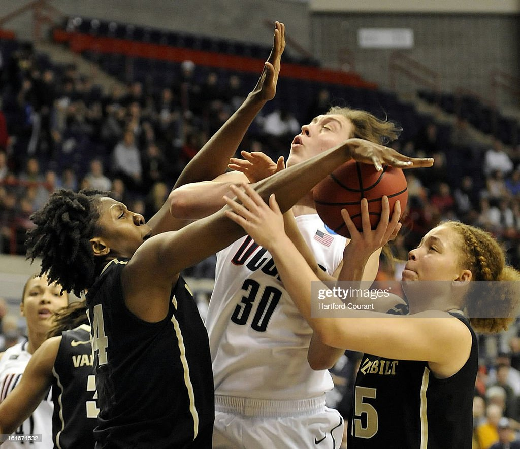 Connecticut Huskies forward Breanna Stewart (30) gets fouled by Vanderbilt Commodores forward Tiffany Clarke (34) during the second half of the women's NCAA Tournament at Gampel Pavilion in Storrs, Connecticut, Monday, March 25, 2013.