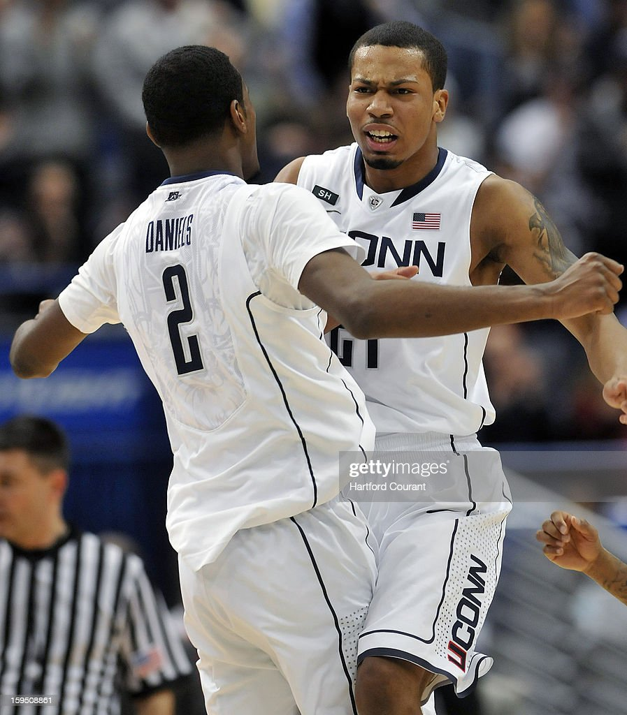 Connecticut Huskies forward DeAndre Daniels (2) congratulates Connecticut Huskies guard Omar Calhoun (21), who scored against the Louisville Cardinals to end the first half at the XL Center on Monday, January 14, 2013, in Hartford, Connecticut.