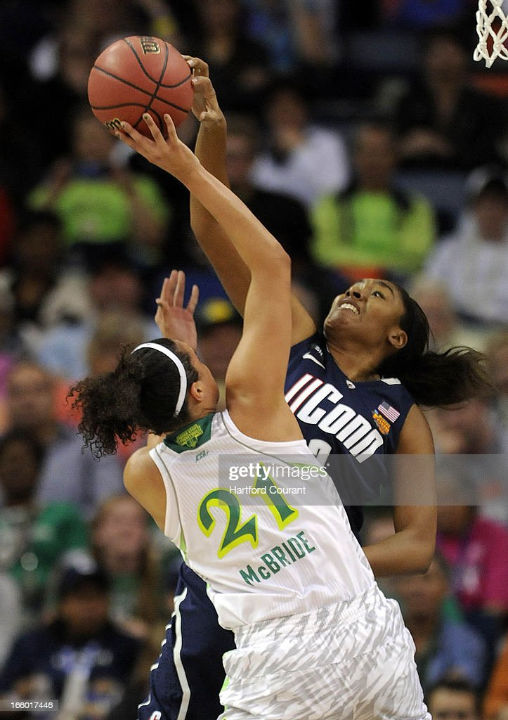 Connecticut Huskies forward Morgan Tuck (3) blocks a shot by Notre Dame Fighting Irish guard Kayla McBride (21) during the first half of the women's NCAA semifinal in New Orleans, Louisiana. UConn won, 83-65.