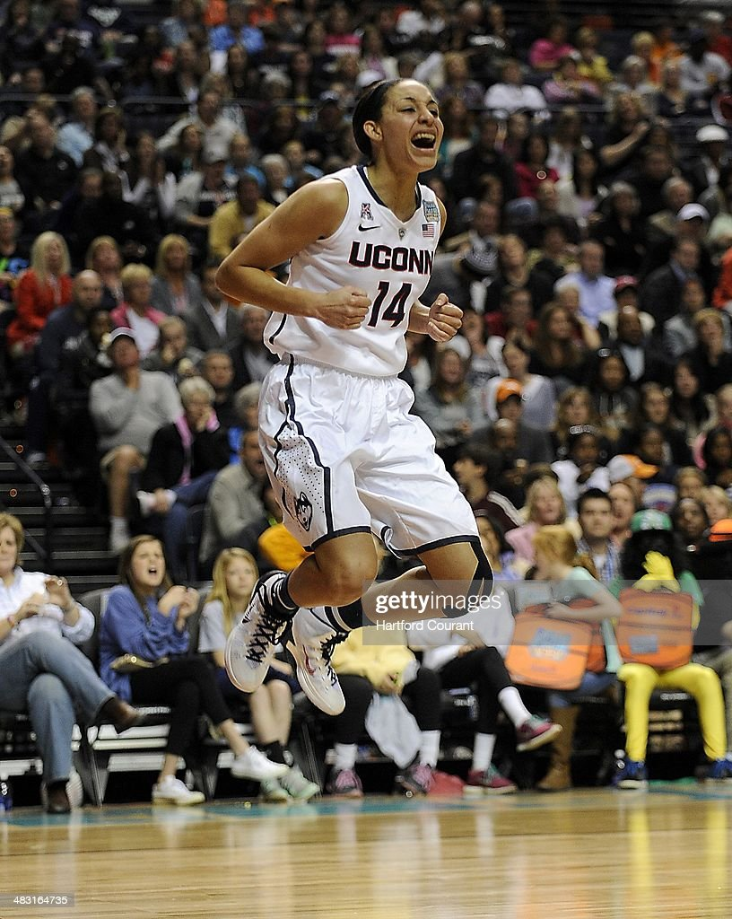 Connecticut Huskies guard Bria Hartley (14) jumps for joy after making a shot and drawing the foul in the second half against Stanford in the NCAA women's college basketball tournament at the Bridgestone Arena in Nashville, Tenn. on Sunday, April 6, 2014. Connecticut Huskies defeated the Stanford Cardinal, 75-56.