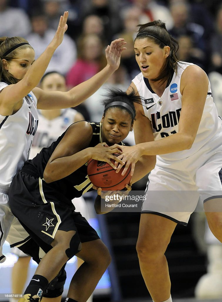 Connecticut Huskies guard Caroline Doty (5) and Connecticut Huskies center Stefanie Dolson (31) double team Vanderbilt Commodores guard Christina Foggie (10) during the first half of the women's NCAA Tournament at Gampel Pavilion in Storrs, Connecticut, Monday, March 25, 2013.