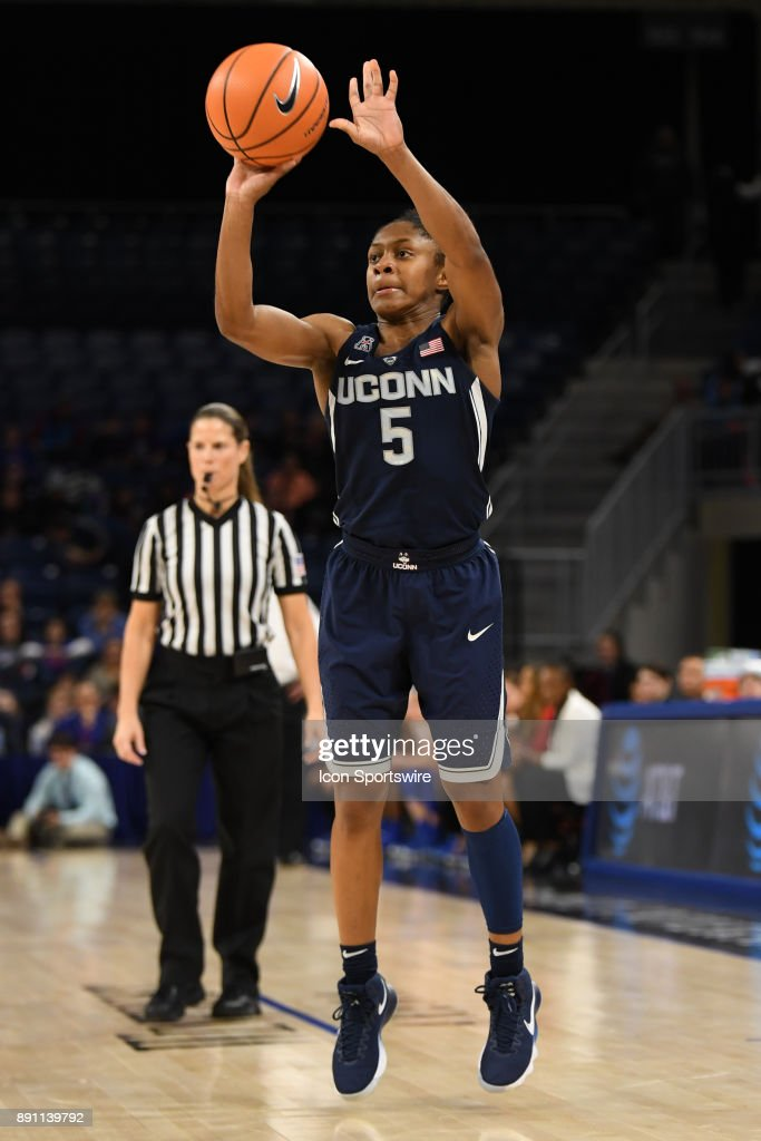 Connecticut Huskies guard Crystal Dangerfield (5) goes up for a three point shot during a game between the Connecticut Huskies and the DePaul Blue Demons on December 8, 2017, at the Wintrust Arena in Chicago, IL. Connecticut won 101-69.