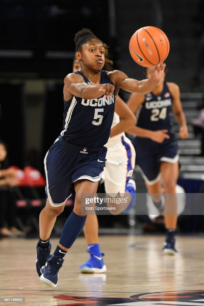 Connecticut Huskies guard Crystal Dangerfield (5) passes the ball during a game between the Connecticut Huskies and the DePaul Blue Demons on December 8, 2017, at the Wintrust Arena in Chicago, IL. Connecticut won 101-69.