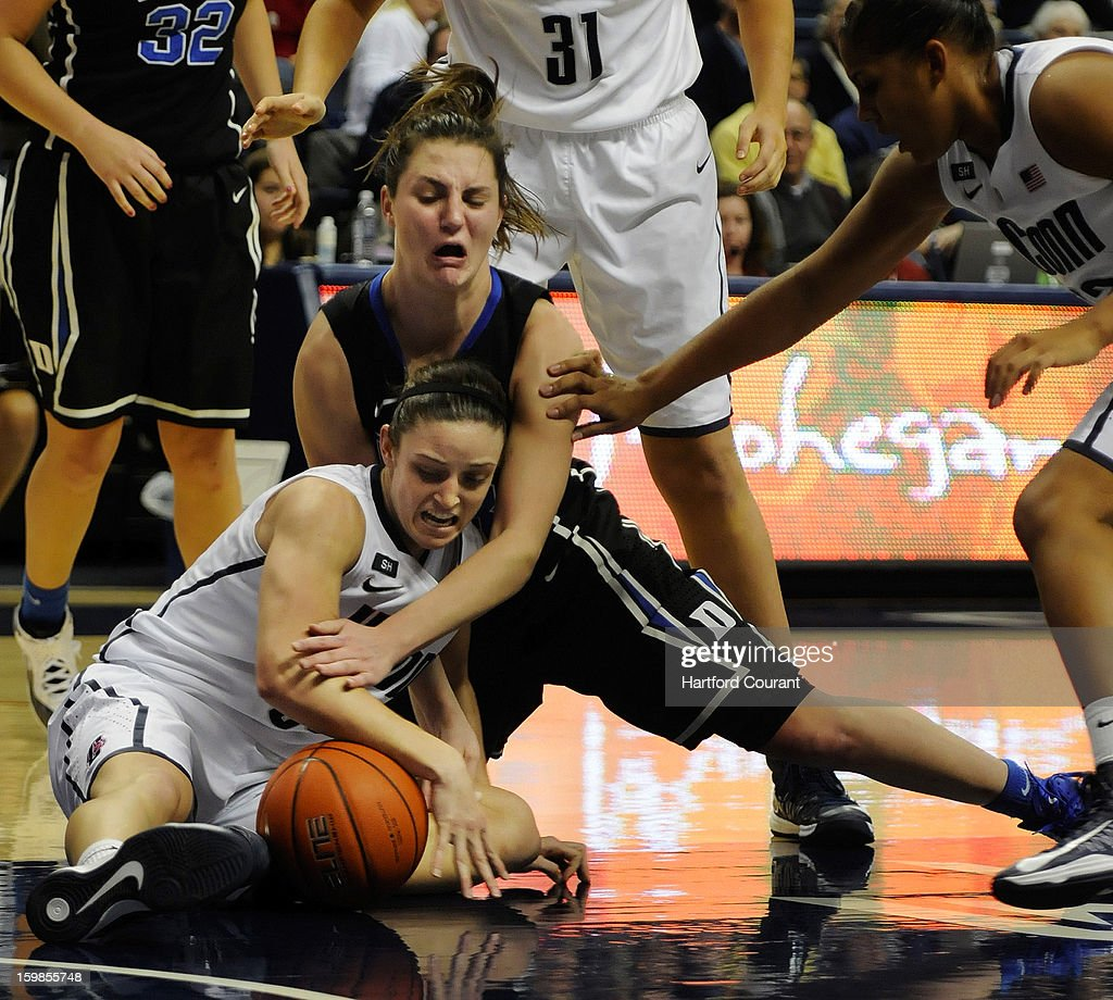 Connecticut Huskies guard Kelly Faris (34) battles Duke Blue Devils guard/forward Haley Peters (33) for a loose ball during the second half in women's college basketball game at Gampel Pavilion on Monday, January 21, 2013, in Storrs, Connecticut.