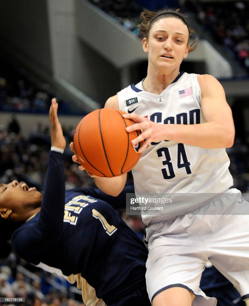 Connecticut Huskies guard Kelly Faris (34) draws the blocking foul on Pittsburgh Panthers guard Loliya Briggs (1) in the first half at the XL Center in Hartford, Connecticut, Tuesday, February 26, 2013.