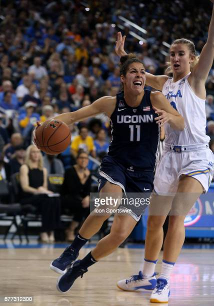 Connecticut Huskies guard Kia Nurse dribbles past UCLA Bruins guard Chantel Horvat during the game on November 21 at Pauley Pavilion in Los Angeles CA