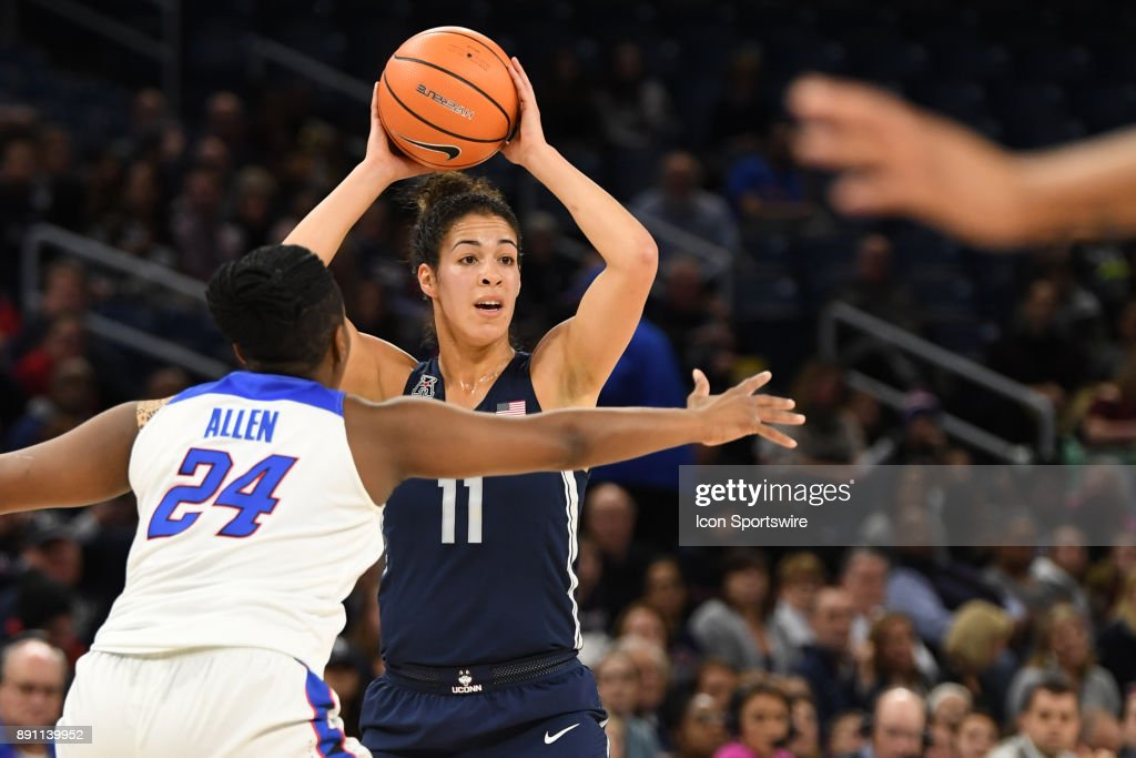 Connecticut Huskies guard Kia Nurse (11) passes the ball against DePaul Blue Demons guard Tanita Allen (24) during a game between the Connecticut Huskies and the DePaul Blue Demons on December 8, 2017, at the Wintrust Arena in Chicago, IL. Connecticut won 101-69.