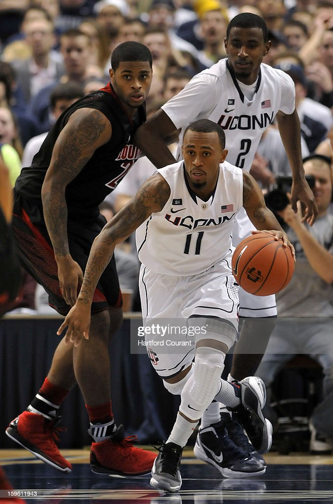 Connecticut Huskies guard Ryan Boatright (11) charges up court after pulling down a rebound during the second half against the Louisville Cardinals at the XL Center on Monday, January 14, 2013, in Hartford, Connecticut.