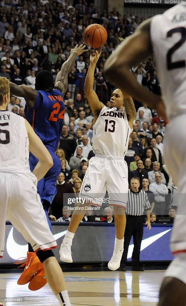 Connecticut Huskies guard Shabazz Napier shoots over Florida Gators forward Casey Prather at Gampel Pavillion in Storrs, Conn., on Monday, Dec. 2, 2013. UConn won, 65-64.