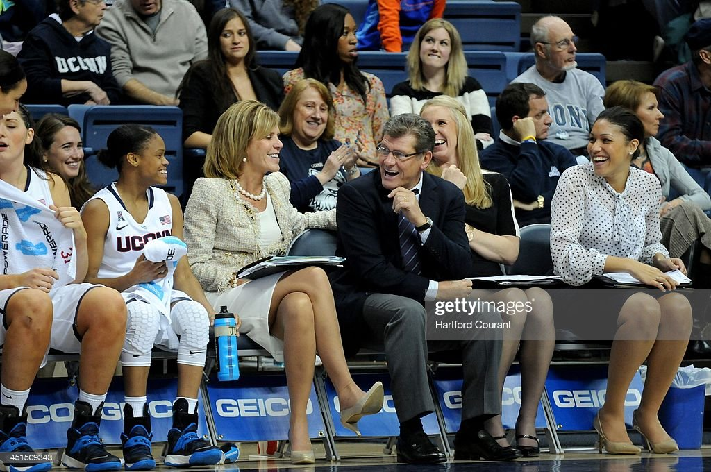 Connecticut Huskies head coach Geno Auriemma and his coaching staff get a chuckle out of the play of some of their freshmen late in the game against Boston University at Gampel Pavilion in Storrs, Conn., Friday, Nov. 22, 2013. UConn defeated Boston U., 96-38.