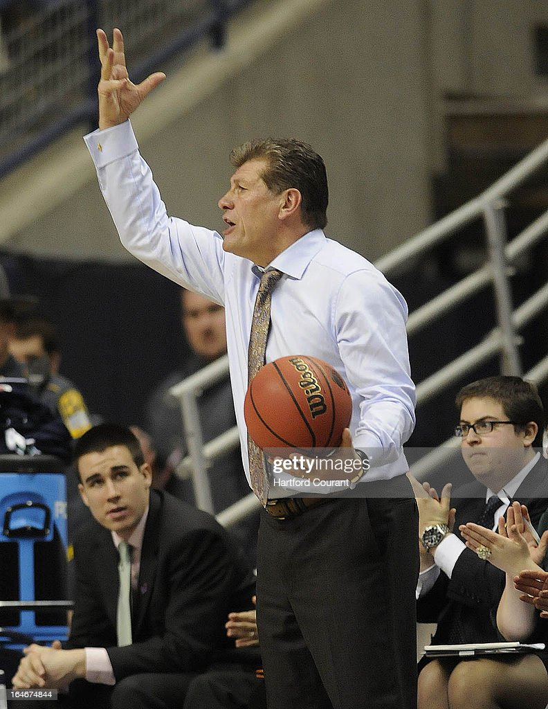Connecticut Huskies head coach Geno Auriemma gestures to his players after he caught a ball that went out of bounds in the first half of the women's NCAA Tournament against the Villanova Commodores at Gampel Pavilion in Storrs, Connecticut, Monday, March 25, 2013.