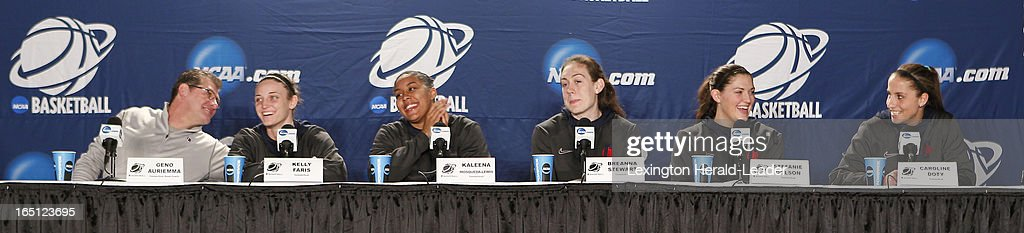 Connecticut Huskies head coach Geno Auriemma, Kelly Faris, Kaleena Mosqueda-Lewis, Breanna Stewart, Stefanie Dolson and Caroline Doty laugh during a press conference at Webster Bank Arena in Bridgeport Connecticut, Sunday, March 31, 2013. The Huskies will face the University of Kentucky on Monday night in the regional finals.