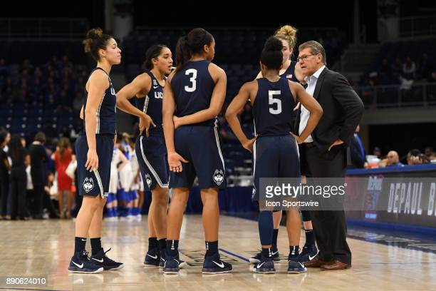 Connecticut Huskies head coach Geno Auriemma talks with his team during a game between the Connecticut Huskies and the DePaul Blue Demons on December...