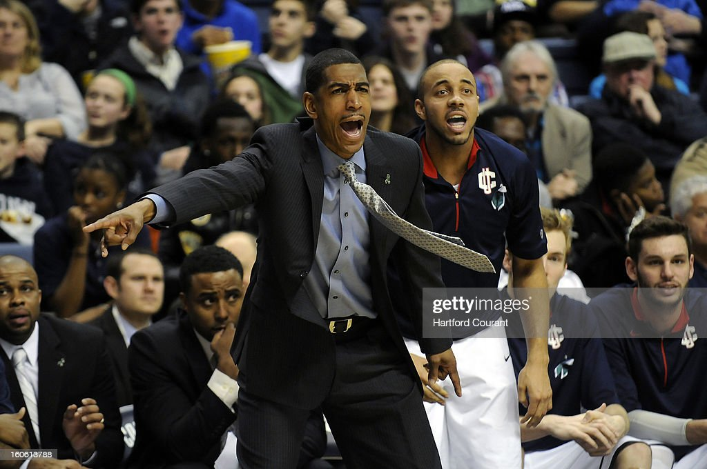 Connecticut Huskies head coach Kevin Ollie shouts instructions to his players while UConn guard R.J. Evans (12) backs him up during the second half against South Florida Bulls at Gampel Pavilion, Sunday, February 3, 2013, in Storrs, Connecticut. UConn won 69-64 in overtime.