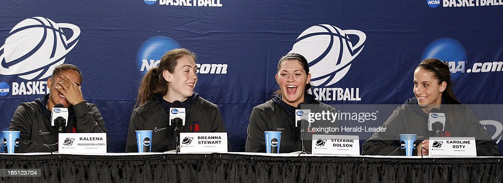 Connecticut Huskies Kaleena Mosqueda-Lewis, Breanna Stewart, Stefanie Dolson, Caroline Doty laugh during a press conference at Webster Bank Arena in Bridgeport Connecticut, Sunday, March 31, 2013. The Huskies will face the University of Kentucky on Monday night in the regional finals.