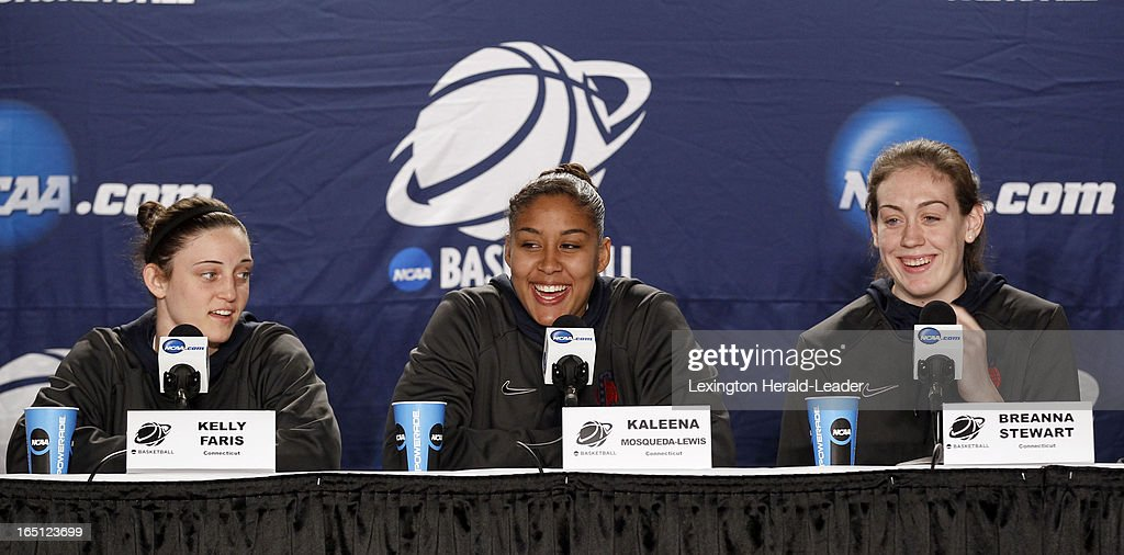 Connecticut Huskies' Kelly Faris, from left, Kaleena Mosqueda-Lewis, Breanna Stewart, laugh during a press conference at Webster Bank Arena in Bridgeport Connecticut, Sunday, March 31, 2013. The Huskies will face the University of Kentucky on Monday night in the regional finals.