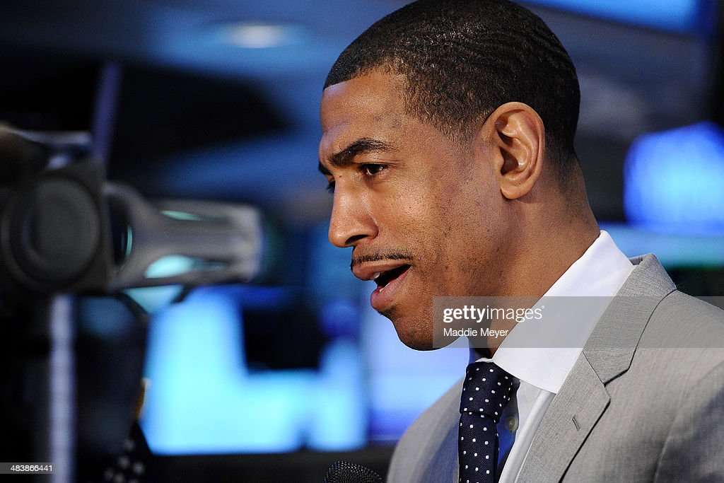 Connecticut Huskies Men's basketball coach <a gi-track='captionPersonalityLinkClicked' href=/galleries/search?phrase=Kevin+Ollie&family=editorial&specificpeople=202896 ng-click='$event.stopPropagation()'>Kevin Ollie</a> answers interview questions on the trading floor of New York Stock Exchange after ringing the closing bell on April 10, 2014 in New York City.