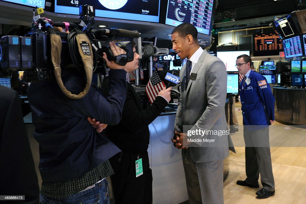 Connecticut Huskies Men's basketball coach Kevin Ollie answers interview questions on the trading floor of New York Stock Exchange after ringing the closing bell on April 10, 2014 in New York City.