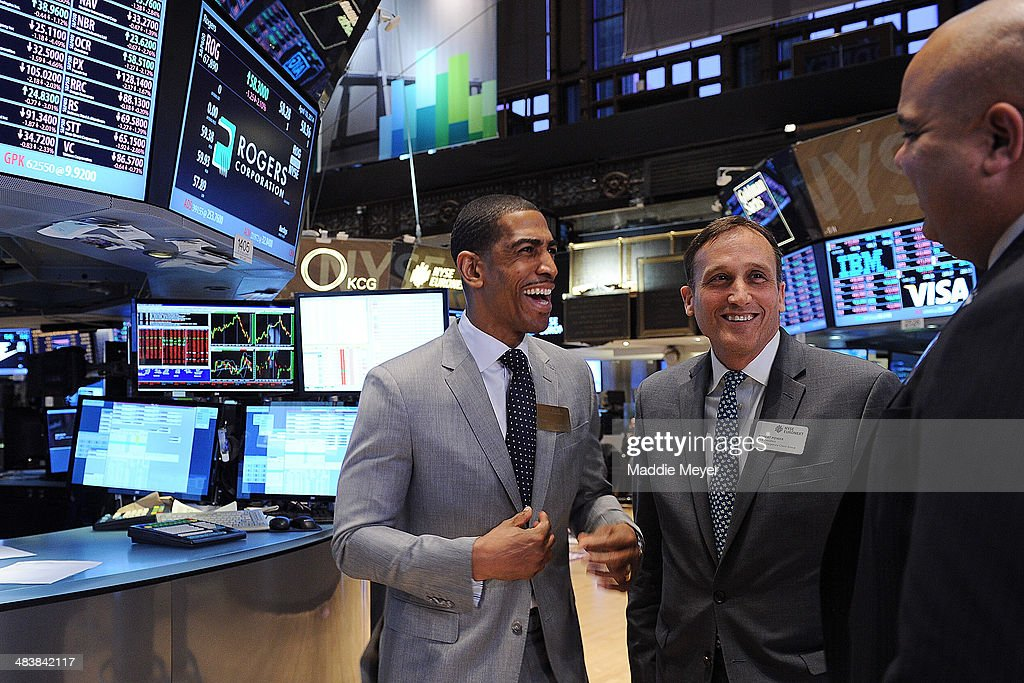 Connecticut Huskies Men's basketball Coach Kevin Ollie, NYSE Vice President Robert Power and University of Connecticut Director of Athletics Warde Manuel talk together after ringing the closing bell at New York Stock Exchange on April 10, 2014 in New York City.