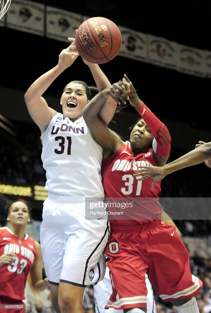 Connecticut Huskies' Stepahnie Dolson battles Ohio State Buckeyes' Raven Ferguson during the first half of the Basketball Hall of Fame Women's Challenge tournament at the Mass Mutual Center in Springfield, Mass., on Sunday, Dec. 1, 2013.