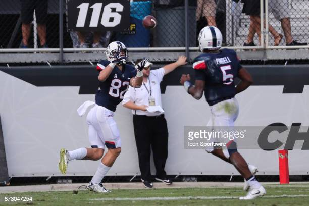 Connecticut Huskies wide receiver Mason Donaldson catches a pass from Connecticut Huskies quarterback David Pindell for a touchdown during the...