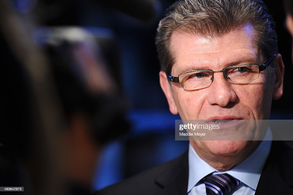 Connecticut Huskies Women's basketball coach <a gi-track='captionPersonalityLinkClicked' href=/galleries/search?phrase=Geno+Auriemma&family=editorial&specificpeople=704607 ng-click='$event.stopPropagation()'>Geno Auriemma</a> answers interview questions on the trading floor of New York Stock Exchange after ringing the closing bell on April 10, 2014 in New York City.
