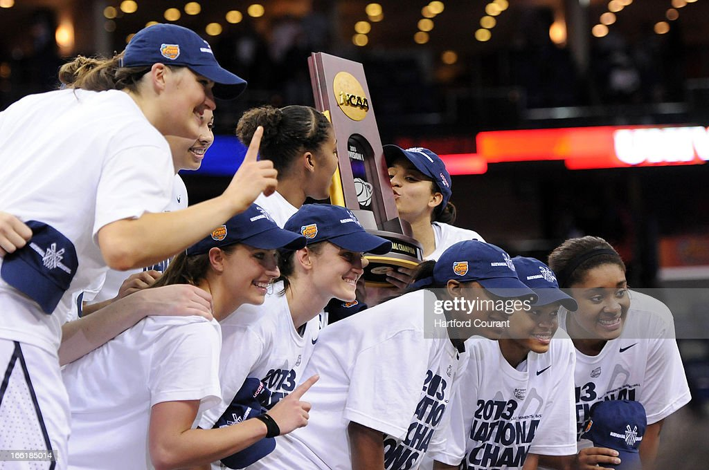 Connecticut players celebrate with the trophy following a 93-60 win against Louisville in the women's NCAA Tournament finals at New Orleans Arena in New Orleans, Louisiana, Tuesday, April 9, 2013.