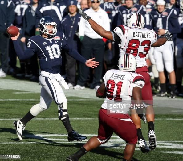 Connecticut quarterback Zack Frazer looks downfield as South Carolina defender Clif Matthews pursues him during the first half of the Papa John'scom...