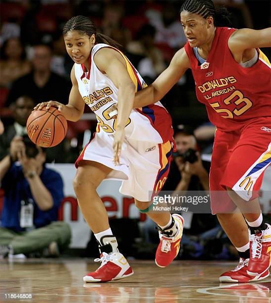 Connecticut recruit Maya Moore dribbles the ball upcourt against Ta'Shia Phillips during the McDonald's All American High School Basketball Games at...