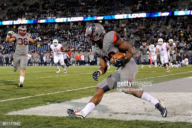 Connecticut safety Obi Melifonwu grabbed his second interception against Temple in the end zone during the second half at Pratt and Whitney Stadium...