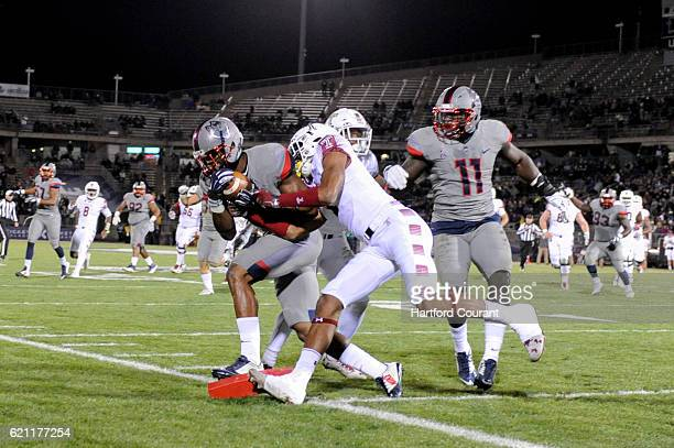 Connecticut safety Obi Melifonwu makes an interception that was ruled down at the 1yard line against Temple at Pratt and Whitney Stadium at...