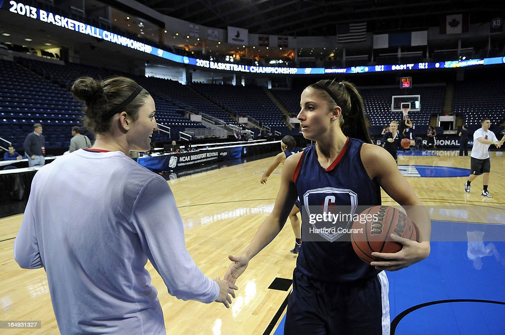 Connecticut seniors Kelly Faris, left, and Caroline Doty shake hands during a practice session for the NCAA Women's Basketball Tournament at the Webster Bank Arena at Harbor Yard in Bridgeport, Connecticut, Friday, March 29, 2013. The UConn women face Maryland in the Sweet 16.