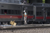 Connecticut state investigator examines the scene of a Metro North train collision on May 18 2013 in Fairfield Connecticut Two New Haven Line Metro...