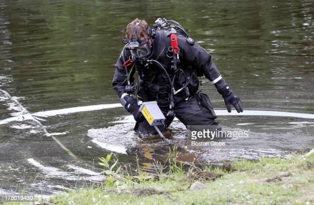 Connecticut State Police officer searches Pine Lake looking for a gun that police believe was used to kill Odin Lloyd in Bristol Conn July 29 2013...