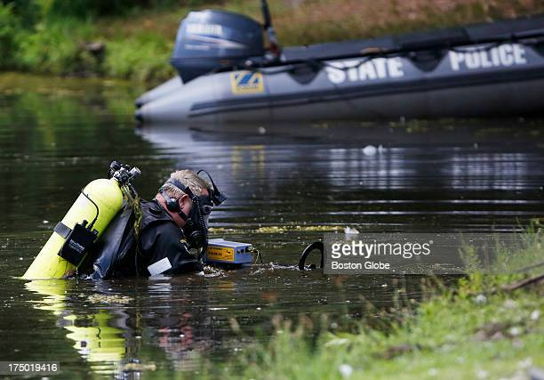 Connecticut State Police officers search Pine Lake looking for a gun that police believe was used to kill Odin Lloyd in Bristol Conn July 29 2013...