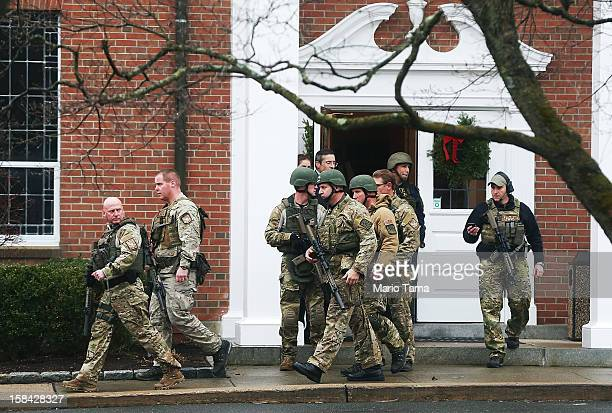 Connecticut State Police officers walk out of St Rose of Lima Roman Catholic Church after a threat to the church was received during the first day of...