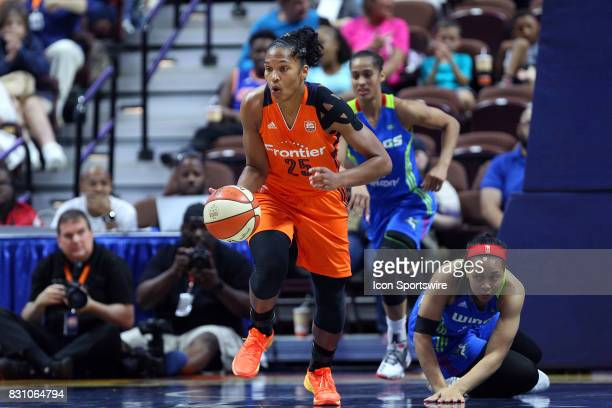 Connecticut Sun forward Alyssa Thomas fast breaks as Dallas Wings guard Allisha Gray looks on during the first half of an WNBA game between Dallas...