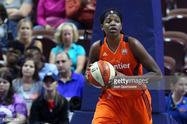 Connecticut Sun forward Jonquel Jones grabs a rebound and starts the fast break during the second half of an WNBA game between Seattle Storm and...