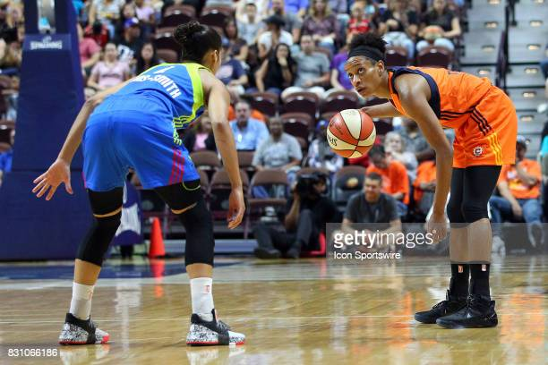 Connecticut Sun guard Jasmine Thomas glances at the shot clock while defended by Dallas Wings guard Skylar DigginsSmith during the first half of an...
